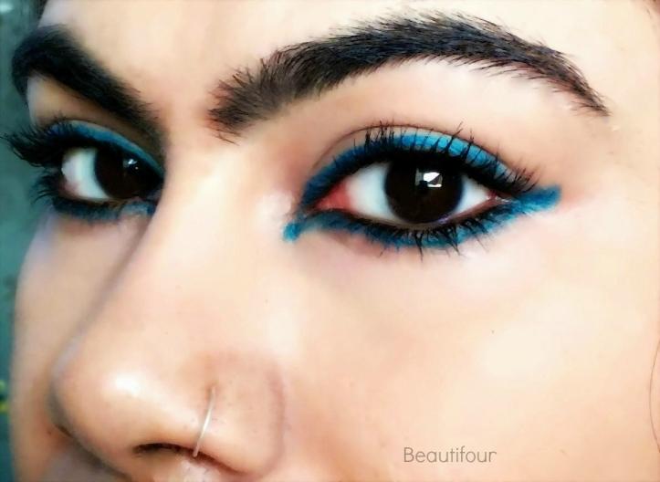 Reverse cat eye using Maybelline Colossal Kohl Turquoise