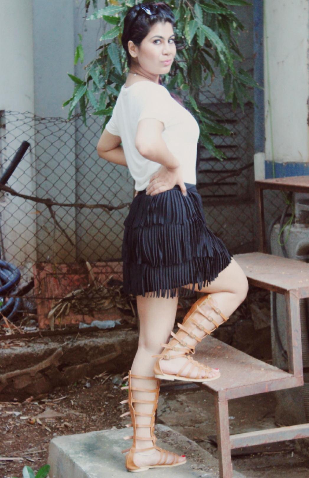 Fringe skirt and gladiator shoes